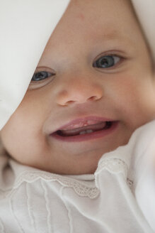 Portrait of smiling baby girl - JLOF00262
