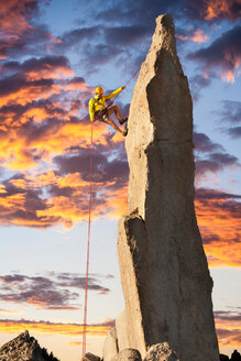 Climber holding on a rope. Beautiful mountain landscape - INGF03382