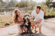 Couple with pet dog, Algonquin Park, Canada - CUF46351