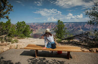Tourist looking out at scenery, Grand Canyon, Arizona, USA - ISF20059