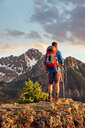 Hiker on mountain peak, Mount Sneffels, Ouray, Colorado, USA - ISF20095