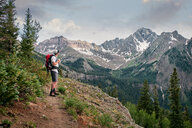 Hiker on mountain peak, Mount Sneffels, Ouray, Colorado, USA - ISF20098