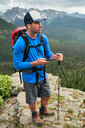Hiker on mountain peak, Mount Sneffels, Ouray, Colorado, USA - ISF20107