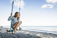 Girl on a swing at the beach - OJF00283