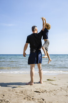 Father and son playing at the beach - OJF00289