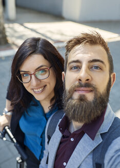 Selfie of happy business couple with scooter - ZEDF01719