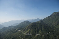 Scenic view of mountains against blue sky - CAVF51485