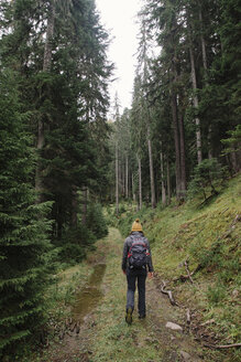 Rear view of woman with backpack walking on trail at Prokletije National Park - CAVF51569