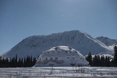 Concrete igloo against mountains and sky at Denali Highway - CAVF51644