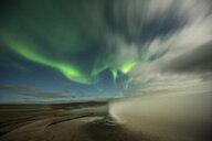 Scenic view of hot spring against aurora borealis - CAVF51800
