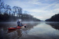 Portrait of man kayaking on Chattahoochee River against sky - CAVF51803