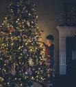 Boy looking at illuminated Christmas Tree - CAVF51899