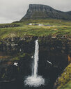 Birds flying over waterfall against cloudy sky - CAVF51974