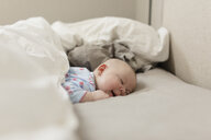 Cute baby girl sleeping on bed at home - CAVF52004