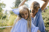Mother and daughter having fun in garden - KNSF05093