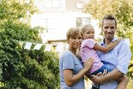 Portrait of happy family in garden - KNSF05114