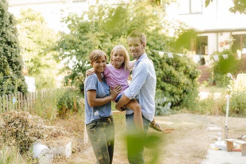 Portrait of happy family in garden - KNSF05117