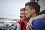 Happy couple on observation deck at the airport - RHF02243