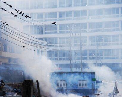 Urban smoke rising by residential apartment block - INGF04293