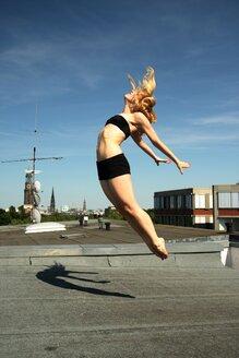 Bikini dancer going through the air - INGF04323