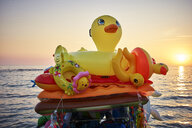 Beach toys at the ocean at sunset - DIKF00294