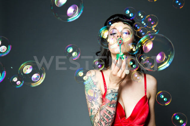 Bubbles woman blowing - INGF04585