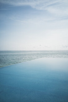 Tranquil blue infinity pool and ocean, Maldives, Indian Ocean - HOXF04148