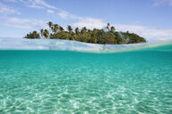 Tropical island beyond idyllic blue ocean water, Vava'u, Tonga, Pacific Ocean - HOXF04166