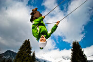 Laughing on a swing in winter - INGF04712