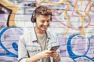 Teenage boy listening to music - LUXF01976