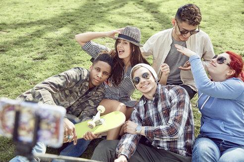 Teenage friends taking selfie at park - LUXF02000