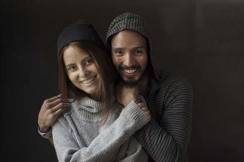 Portrait of happy couple in warm clothing - TGBF00349