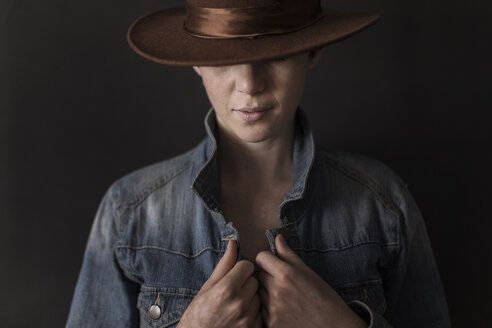 Young woman wearing denim jacket and hat - TGBF00367