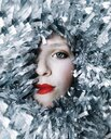 Half face of a woman surrounded by silver garlands - INGF05345