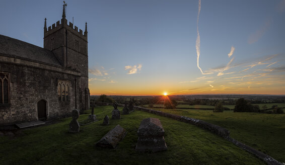 United Kingdom, England, Old Sodbury, Church of Saint John the Baptist at sunset - ALR01354