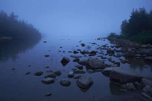 Scenic view of Jordan Pond in foggy weather - TGBF00565