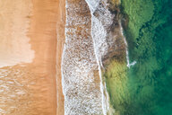 Spain, Asturias, Aerial view of surfers in the water on a beach - MGOF03822