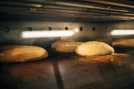 Bread baking in oven in a bakery - OCMF00046
