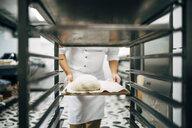 Baker working preparing tray to make bread - OCMF00049