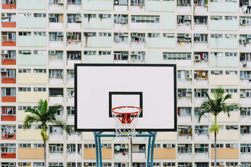 China, Hong Kong, Kowloon, basketball hoop, public housing in the background - GEMF02440