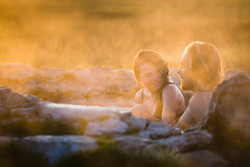 Happy Woman Relaxing With Boyfriend In Hot Spring - TGBF00936