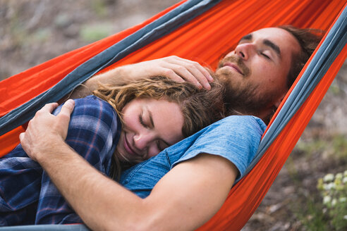 Man Embracing Woman While Sleeping On Hammock - TGBF00969