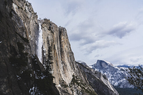 Low angle view of mountains at Yosemite National Park against sky during winter - CAVF52353