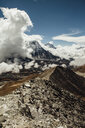 Scenic view of mountains against cloudy sky during sunny day - CAVF52368