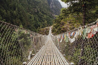 Diminishing perspective of footbridge amidst mountains at Sagarmatha National Park - CAVF52371