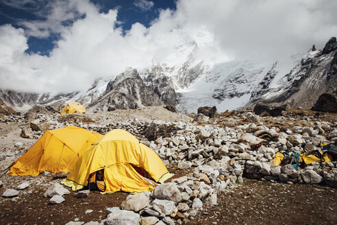 Tents on mountain against cloudy sky during sunny day - CAVF52380