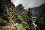 Friends hiking at Sagarmatha National Park against cloudy sky - CAVF52389