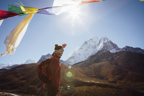 Hiker looking at view while standing against clear sky during sunny day - CAVF52401