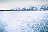 Scenic view of frozen lake and snow covered mountains - TGBF01264