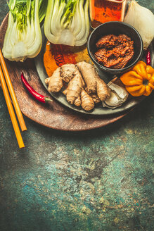 High angle view of spices in on a rustic table - INGF05602